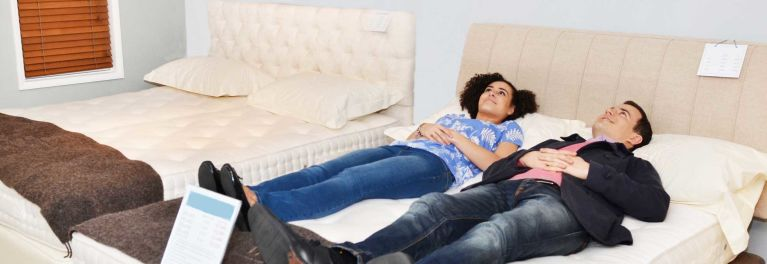 couple trying out a mattress